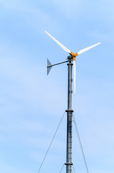 small Wind turbines on blue sky
